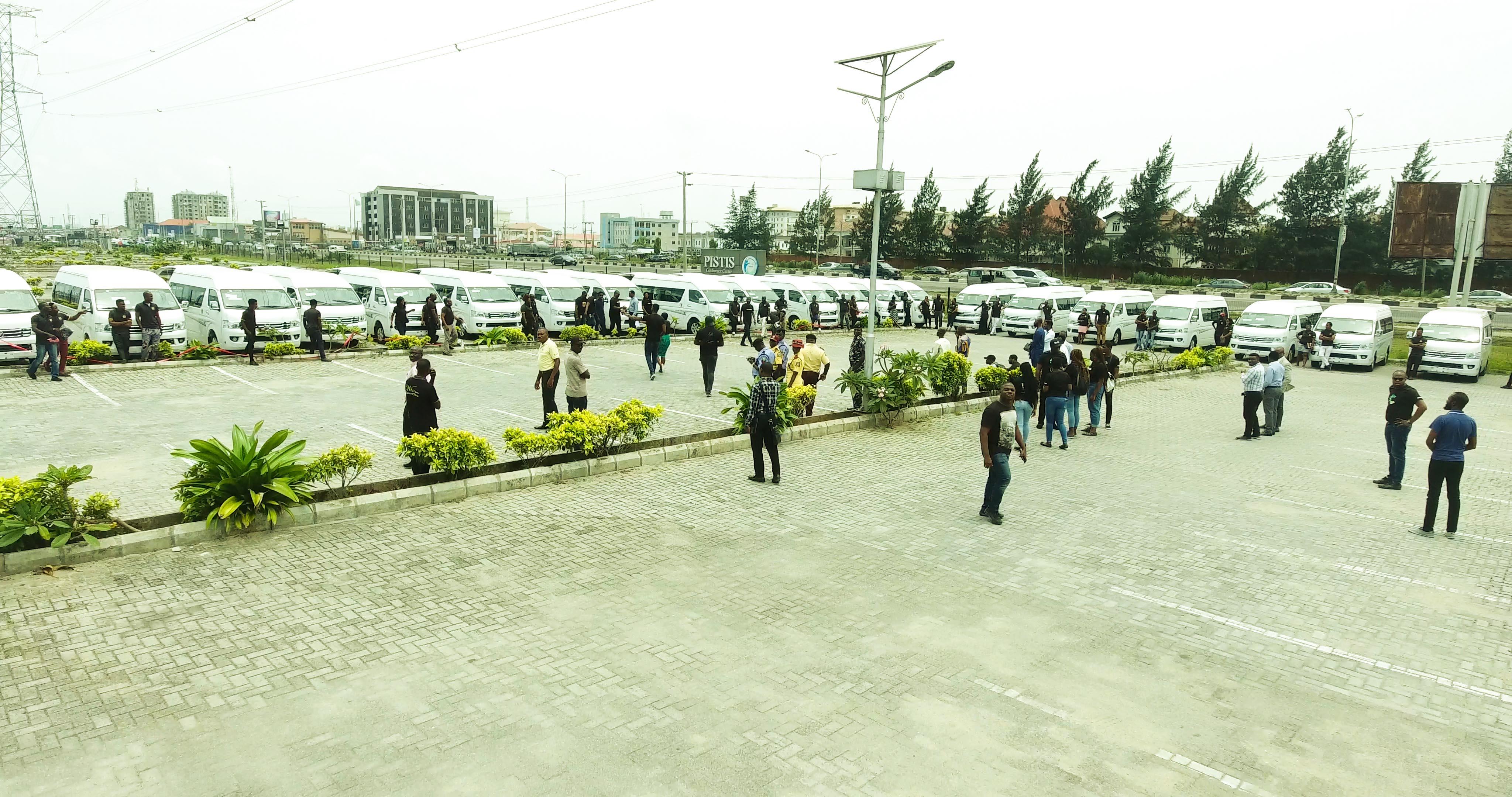 Pliots Standing next to their PlentyWaka bus